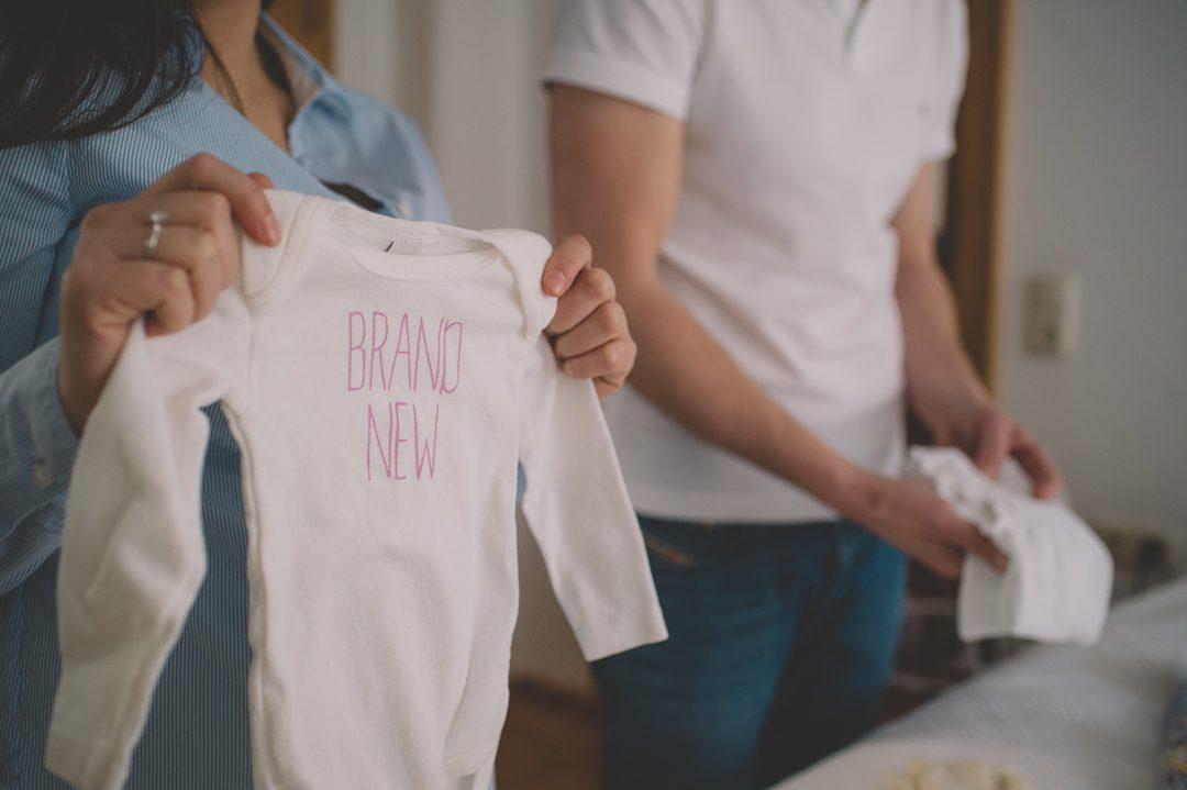 Baby Strampler mit Aufschrift Brand New